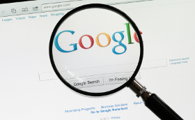 Google search engine with magnifying glass in front
